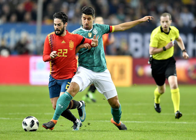 Spain's Isco Alarcon, left, and Germany's Sami Khedira, right, challenge for the ball during an international friendly soccer match between Germany and Spain in Duesseldorf, Germany, Friday, March 23, 2018. (AP Photo/Martin Meissner)