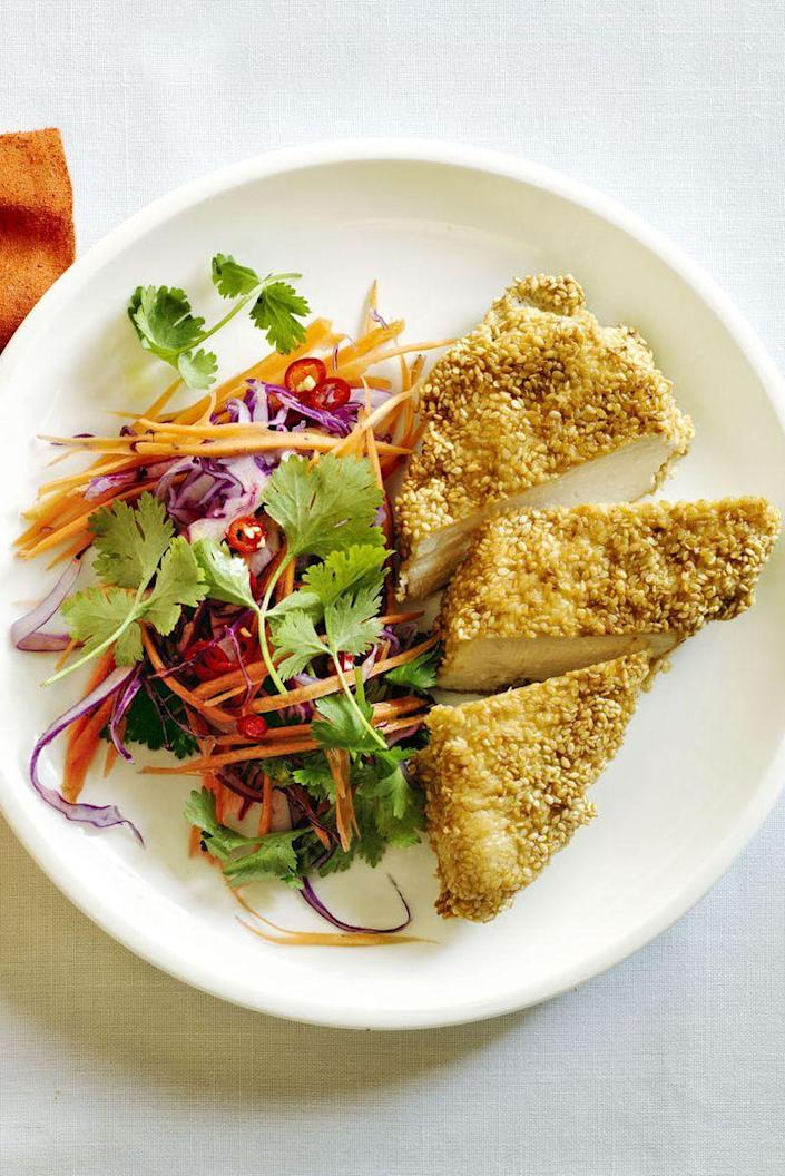 """<p>Sesame-crusted chicken breasts pair perfectly with a zesty slaw. </p><p><em><a href=""""https://www.womansday.com/food-recipes/food-drinks/recipes/a57922/sesame-chicken-chili-lime-slaw-recipe/"""" rel=""""nofollow noopener"""" target=""""_blank"""" data-ylk=""""slk:Get the Sesame Chicken and Chili Lime Slaw recipe."""" class=""""link rapid-noclick-resp"""">Get the Sesame Chicken and Chili Lime Slaw recipe.</a></em></p>"""