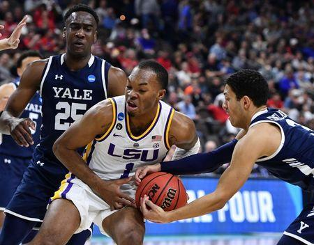 Mar 21, 2019; Jacksonville, FL, USA; LSU Tigers guard Javonte Smart (1) battles Yale Bulldogs guard Alex Copeland (right) for the ball as Yale guard Miye Oni (25) looks on during the second half in the first round of the 2019 NCAA Tournament at Jacksonville Veterans Memorial Arena. Mandatory Credit: John David Mercer-USA TODAY Sports