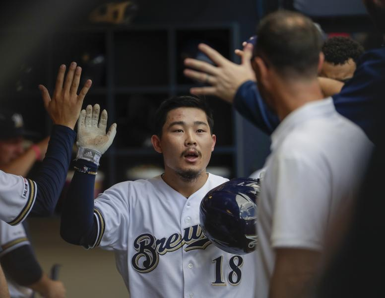 Milwaukee Brewers' Keston Hiura is congratulated after hitting a home run during the fourth inning of a baseball game against the St. Louis Cardinals Wednesday, Aug. 28, 2019, in Milwaukee. (AP Photo/Morry Gash)