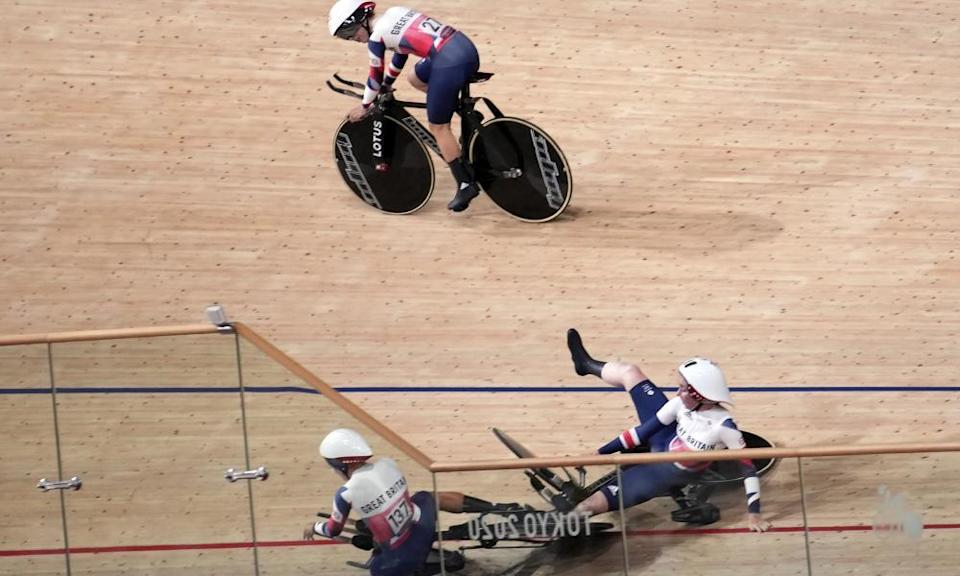 GB's Laura Kenny watches as her fellow team pursuit riders crash.