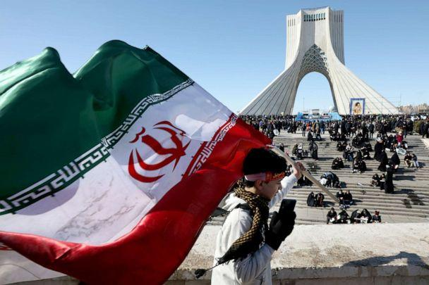PHOTO: A boy carries an Iranian flag in front of Azadi (Freedom) monument tower in a rally celebrating the 41st anniversary of the Islamic Revolution, in Tehran, Iran, Feb. 11, 2020. (Vahid Salemi/AP)
