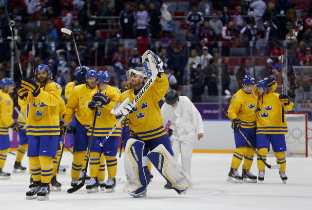 Sweden goaltender Henrik Lundqvist celebrates with teammates after Sweden beat Finland 2-1 in a men's semifinal ice hockey game at the 2014 Winter Olympics, Friday, Feb. 21, 2014, in Sochi, Russia. (AP Photo/Petr David Josek)