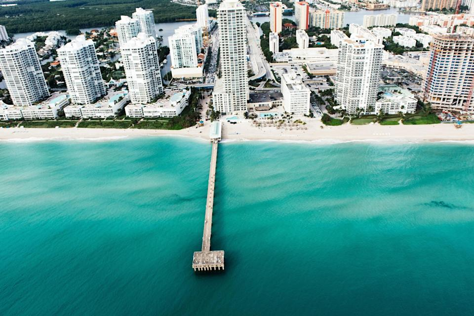 "<p>With placid, sapphire water and few crowds, this two-mile swath of Miami Beach is delightfully quiet compared to its neighbors. The stretch is lined mainly with residential condos—some low-rises redolent of old Miami, some skyscraping showstoppers, a testament to Miami's new contemporary edge.</p> <p><strong>Who it's best for:</strong> Families and couples who want a beautiful beach without all the fuss</p> <p><strong>The vibe:</strong> Relaxed and ideal for quiet days in the sun</p> <p><strong>Where to stay:</strong> The beauty of Miami's northernmost beach is underscored by the over-the-top landscape of <a href=""https://www.cntraveler.com/hotels/united-states/n-miami-beach/acqualina-resort-spa-miami-beach?mbid=synd_yahoo_rss"" rel=""nofollow noopener"" target=""_blank"" data-ylk=""slk:Acqualina Resort & Residences on the Beach"" class=""link rapid-noclick-resp"">Acqualina Resort & Residences on the Beach</a> and its fabulous beach club, exclusive to hotel guests.</p>"