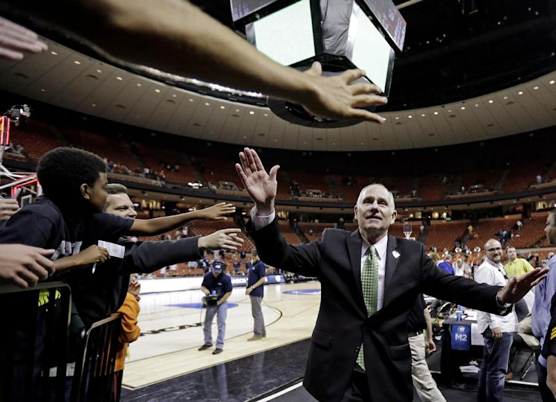 FILE - In this March 24, 2013, file photo, Miami head coach Jim Larranaga celebrates with fans after their 63-59 win over Illinois in a third-round game of the NCAA college basketball tournament in Austin, Texas. (AP Photo/Eric Gay, File)