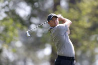 Rory McIlroy tees off on the fourth hole during a practice round for the Masters golf tournament at Augusta National Golf Club on Wednesday, April 7, 2021, in Augusta, Ga. (Curtis Compton/Atlanta Journal-Constitution via AP)