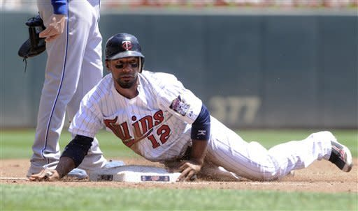 Minnesota Twins' Alexi Casilla steals third during a double steal with Denard Span in the second inning in the first baseball game of a doubleheader against the Kansas City Royals, Saturday, June 30, 2012, in Minneapolis. (AP Photo/Jim Mone)