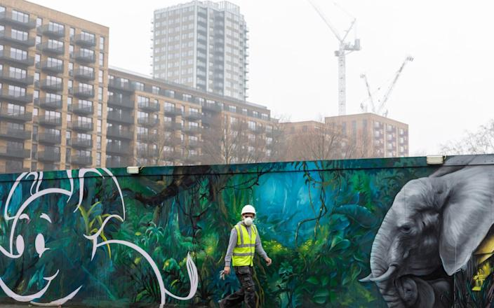 Londoner in protective face mask is seen walking on a rainy day in Elephant and Castle  - Dominika Zarzycka/NurPhoto