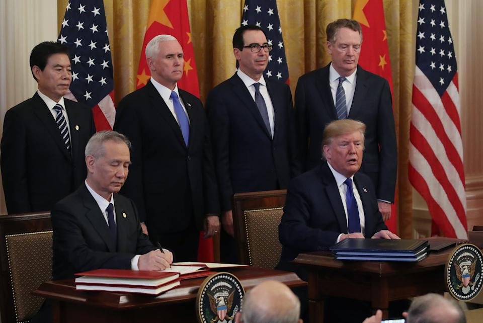 WASHINGTON, DC - JANUARY 15: U.S. President Donald Trump and Chinese Vice Premier Liu He sign phase 1 of a trade deal between the U.S. and China, in the East Room at the White House, on January 15, 2020 in Washington, DC. Phase 1 is expected to cut tariffs and promote Chinese purchases of U.S. farm, and manufactured goods while addressing disputes over intellectual property. Also pictured in rear are Vice President Mike Pence (2nd L), Treasury Secretary Steve Mnuchin (2nd R) and US Trade Representative Robert Lighthizer (R). (Photo by Mark Wilson/Getty Images)