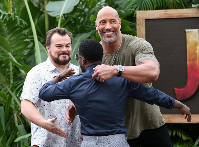 <p>The stars of <em>Jumanji: Welcome to the Jungle</em> hugged it out at a photocall for the new flick at the Four Seasons Resort Oahu in Kapolei, Hawaii, on Monday. (Photo: Darryl Oumi/Getty Images) </p>