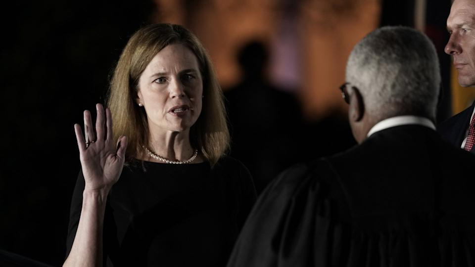 Mandatory Credit: Photo by Ken Cedeno/POOL/EPA-EFE/Shutterstock (10976023f)Associate Justice of the Supreme Court Clarence Thomas (R) administers the oath of office to Judge Amy Coney Barrett (L) to be Associate Justice of the Supreme Court on the South Lawn of the White House in Washington, DC, USA, 26 October 2020.