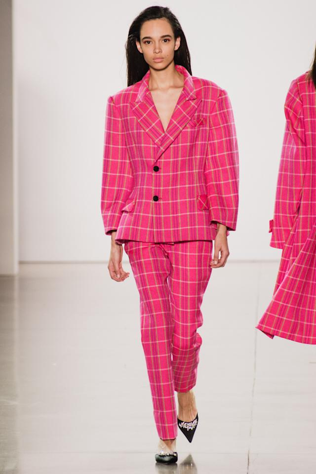 <p>Model wears a hot pink plaid suit at the fall 2018 Matthew Adams Dolan show.(Photo: Getty Images) </p>