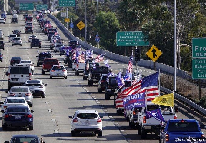 A caravan in support of President Donald Trump rolls into San Diego