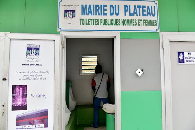<p>A public toilet in the Plateau business district of Abidjan, Ivory Coast. (Photo: Issouf Sanogo/AFP/Getty Images) </p>