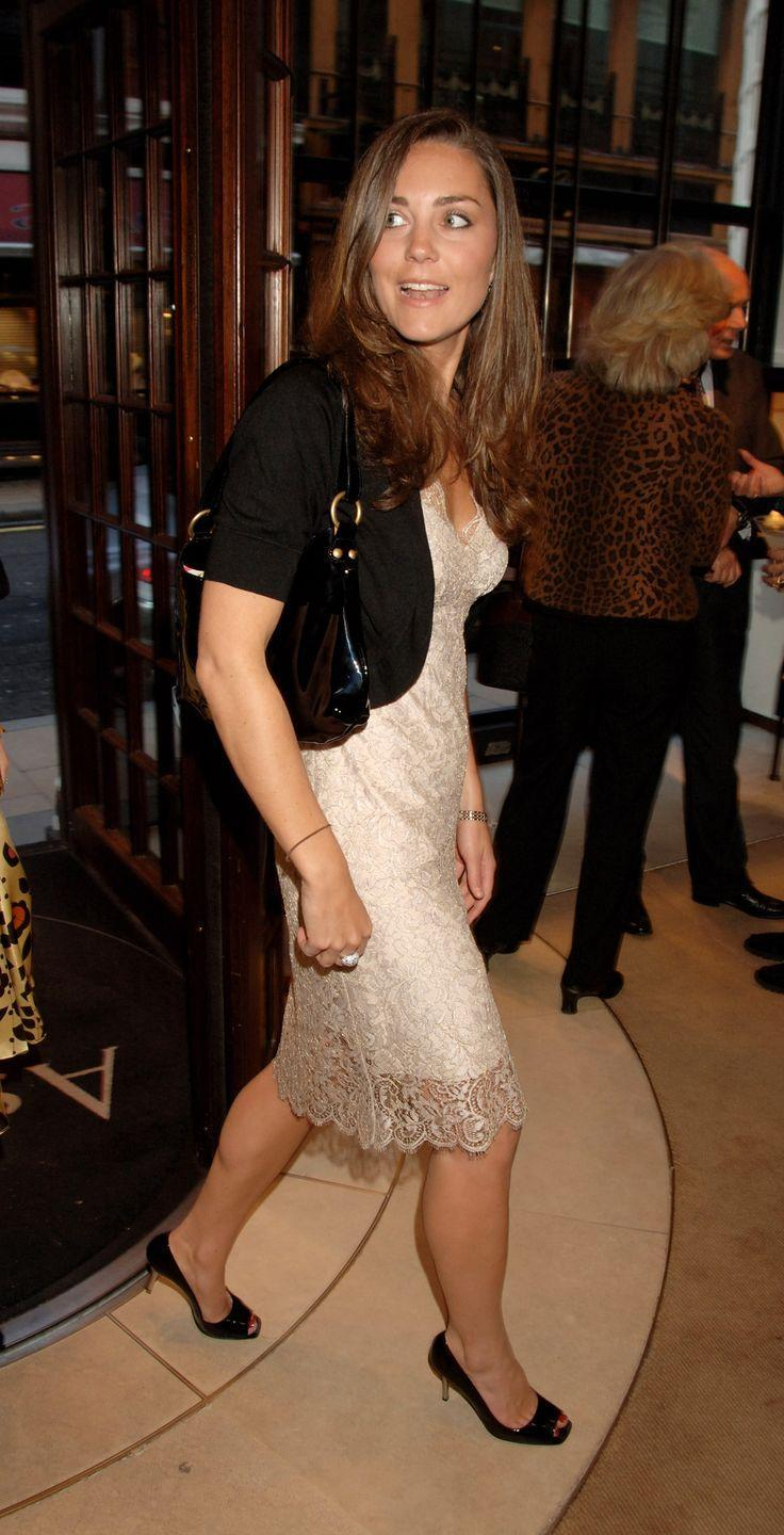 <p> Leaving a book launch party in London wearing a knee-length lace dress. </p>
