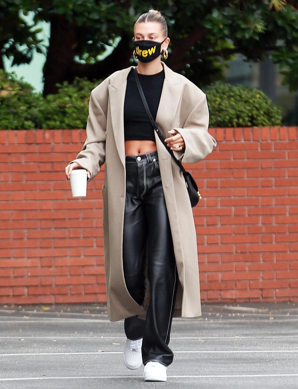 <p>Back from a photo shoot in Italy, Hailey Bieber makes a Sunday morning trip to Blue Bottle Cafe in Beverly Hills while looking chic in a sleek bun and long coat.</p>