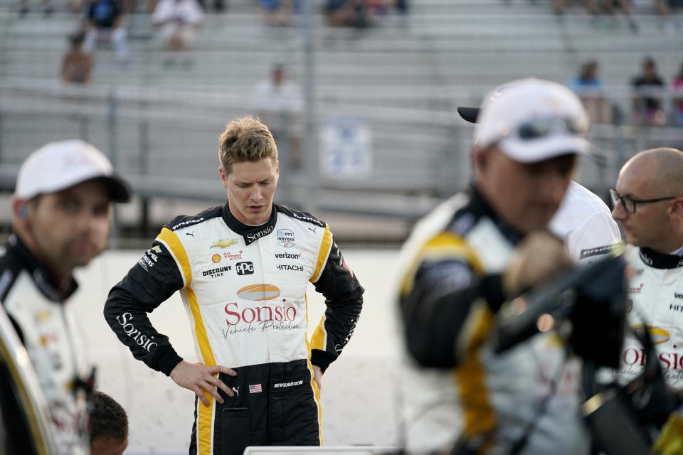 Josef Newgarden (2) prepares before the start an IndyCar auto race at World Wide Technology Raceway on Saturday, Aug. 21, 2021, in Madison, Ill. (AP Photo/Jeff Roberson)