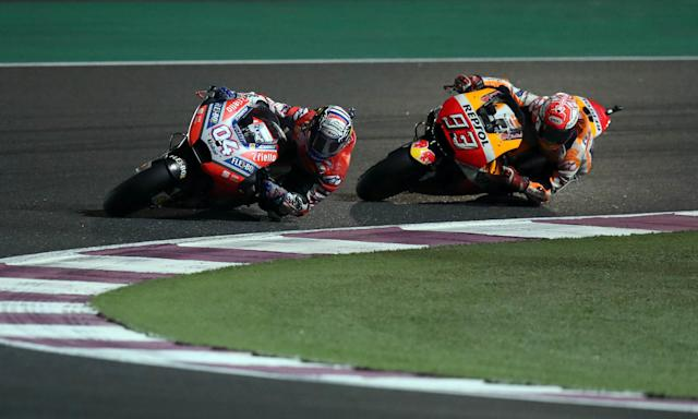 Motorcycle Racing - Qatar Motorcycle Grand Prix - MotoGP race - Losail, Qatar - March 18, 2018 - Ducati Team rider Andrea Dovizioso of Italy and Repsol Honda Team rider Marc Marquez of Spain compete. REUTERS/Ibraheem Al Omari