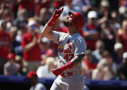 St. Louis Cardinals' Rangel Ravelo gestures as he crosses home plate after hitting a solo home run off Colorado Rockies starting pitcher Tim Melville in the second inning of a baseball game Thursday, Sept. 12, 2019, in Denver. (AP Photo/David Zalubowski)