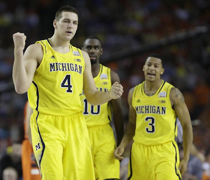 Michigan's Mitch McGary, Michigan's Tim Hardaway Jr. and Michigan's Trey Burke, from left, react to play against Syracuse during the first half of the NCAA Final Four tournament college basketball semifinal game Saturday, April 6, 2013, in Atlanta. (AP Photo/Charlie Neibergall)