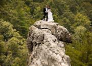 "<div class=""caption-credit""> Photo by: John Ewing</div><div class=""caption-title"">6. 900 Feet Above the Ground</div>With its awe-inspiring views and intimate, serene vibe, the South Peak of Seneca Rocks in West Virginia is a stunning place to tie the knot - if you're daring enough to climb up to the 900-foot summit. <b><a href=""http://www.bridalguide.com/blogs/bridal-buzz/seneca-rocks-wedding"" rel=""nofollow noopener"" target=""_blank"" data-ylk=""slk:Avid rock climbers Bob and Antonie Ewing did just that"" class=""link rapid-noclick-resp"">Avid rock climbers Bob and Antonie Ewing did just that</a></b> earlier this year."