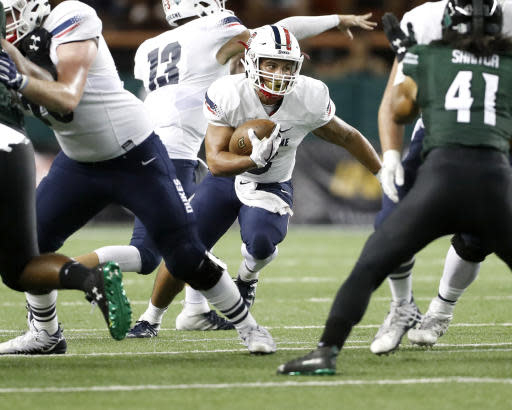 Duquesne running back P.J. Fulmore (3) cuts through the Hawaii defense during the third quarter of an NCAA college football game Saturday, Sept. 22, 2018, in Honolulu. (AP Photo/Marco Garcia)