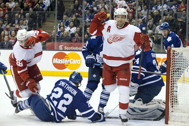 Detroit Red Wings' Pavel Datsyuk, center right, celebrates after scoring on Toronto Maple Leafs goaltender James Reimer, right, during first period NHL hockey action in Toronto on Saturday, Dec 21, 2013. (AP Photo/The Canadian Press, Chris Young, File)