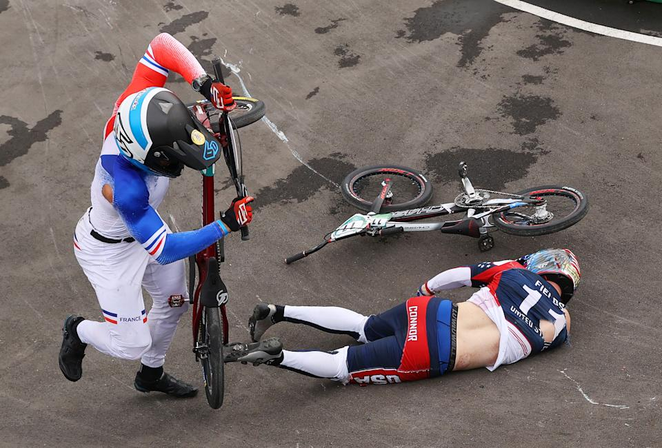 TOKYO, JAPAN - JULY 30: Romain Mahieu of Team France and Connor Fields of Team United States crash during the Men's BMX semifinal heat 1, run 3 on day seven of the Tokyo 2020 Olympic Games at Ariake Urban Sports Park on July 30, 2021 in Tokyo, Japan. (Photo by Francois Nel/Getty Images)