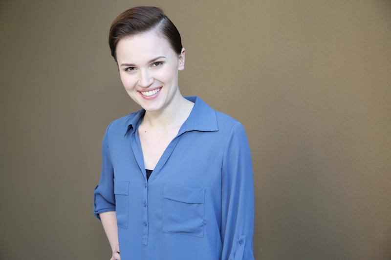 """In this Saturday, March 8, 2014 photo, Veronica Roth, author of the book """"Divergent,"""" poses for a portrait in Beverly Hills, Calif. The movie, """"Divergent,"""" directed by Neil Burger, stars Shailene Woodley, Theo James and Kate Winslet and releases on Friday, March 21, 2014. (Photo by Annie I. Bang /Invision/AP)"""