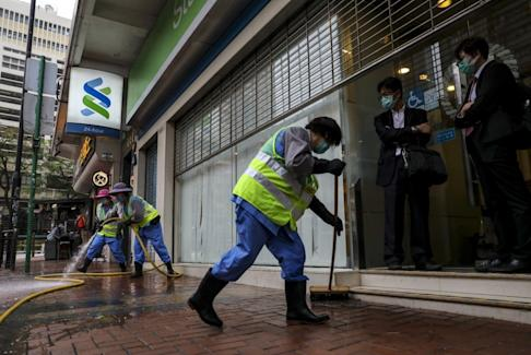 The area around a Standard Chartered branch in Chung On Street, Tsuen Wan, is deep-cleaned after a member of staff caught the virus. Photo: Winson Wong