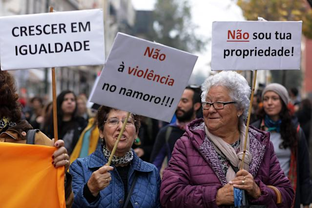 "<p>Two elderly women hold banners with the words ""I'm not your property"" (right) and ""No to the violence in relationship"" (center) as another woman holds another with the words ""growing equal"" during a demonstration marking the International Day for the Elimination of Violence Against Women in Lisbon, Portugal, Nov. 25, 2017. (Photo: Antonio Cotrim/EPA-EFE/REX/Shutterstock) </p>"