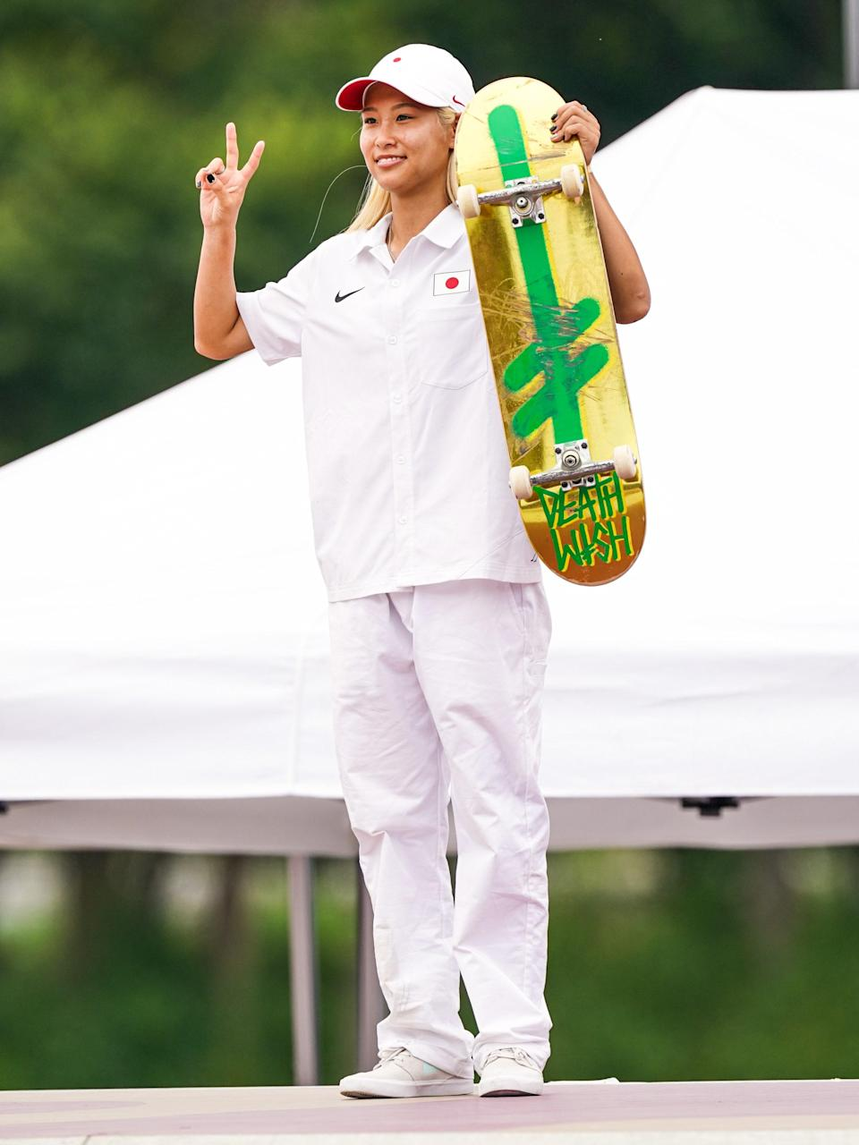 Japan's Aori Nishimura also went for the button-up, all-white option.