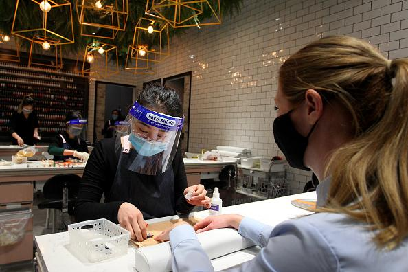 Nail Technician Lily Nguyen is seen wearing a mask and face shield at the Depot Nail Bar in Broadway Shopping Centre, Sydney, Australia.