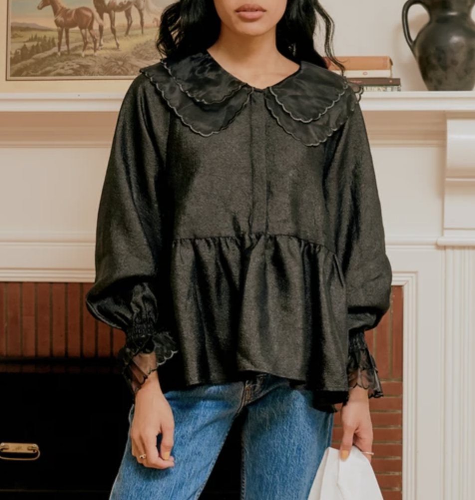 """A relaxed yet polished babydoll top, ideal for staying comfortable after a night of holiday indulgence. $129, Lisa Says Gah. <a href=""""https://lisasaysgah.com/products/lenacras-blouse-black?"""" rel=""""nofollow noopener"""" target=""""_blank"""" data-ylk=""""slk:Get it now!"""" class=""""link rapid-noclick-resp"""">Get it now!</a>"""
