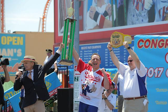 <p>Joey Chestnut is named winner of the Nathan's Famous Fourth of July International Hot Dog-Eating Contest at Coney Island in Brooklyn, New York City, U.S., July 4, 2017. (Andrew Kelly/Reuters) </p>