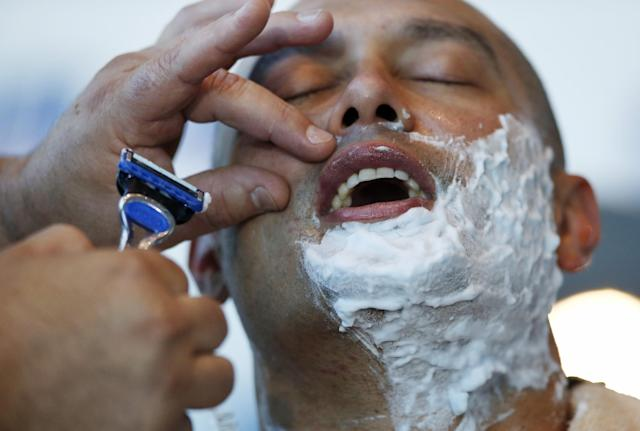 Boston Red Sox baseball player Shane Victorino is shaved for One Fund Boston, the Boston Marathon charity for bombing victims, during a shave-off in Boston, Monday, Nov. 4, 2013. The Red Sox players' beards became a symbol of their solidarity as they went from worst in the AL East last year to first this year by winning the team's third World Series title in a decade. (AP Photo/Elise Amendola)