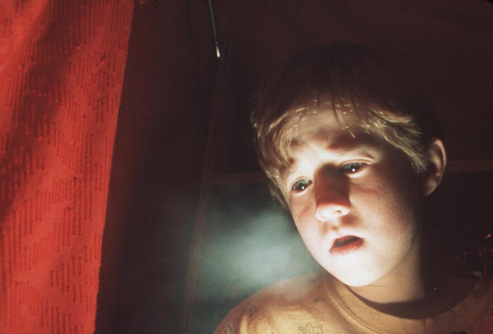 """Frightened By His Paranormal Powers, 8-Year-Old Cole Sear (Haley Joel Osment) Is Too Young To Understand His Purpose In """"The Sixth Sense."""" 1999 Spyglass Entertainment Group, Lp. All Rights Reserved. (Photo By Getty Images)"""