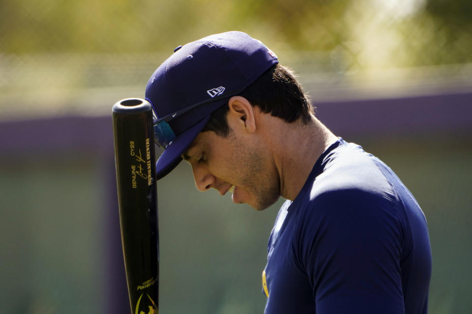 Milwaukee Brewers' Christian Yelich gets ready for batting practice during the team's spring training baseball workout in Phoenix , Tuesday, Feb. 23, 2021. (AP Photo/Jae C. Hong)