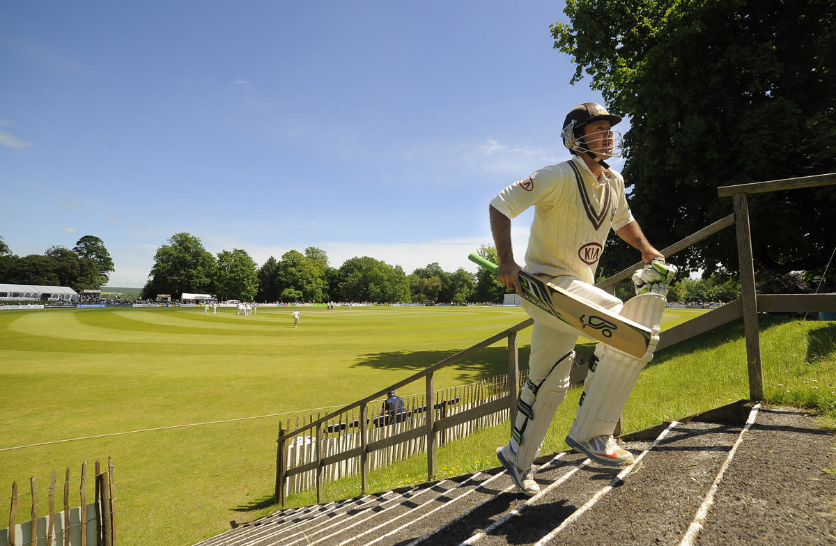 ARUNDEL, ENGLAND - JUNE 14: Ricky Ponting of Surrey walks back to the pavilion dejected after being caught behind by Sussex's Chris Jordan for 13 during day three of the LV County Championship match between Sussex and Surey at Arundel Castle on June 14, 2013 in Arundel, England. (Photo by Charlie Crowhurst/Getty Images)