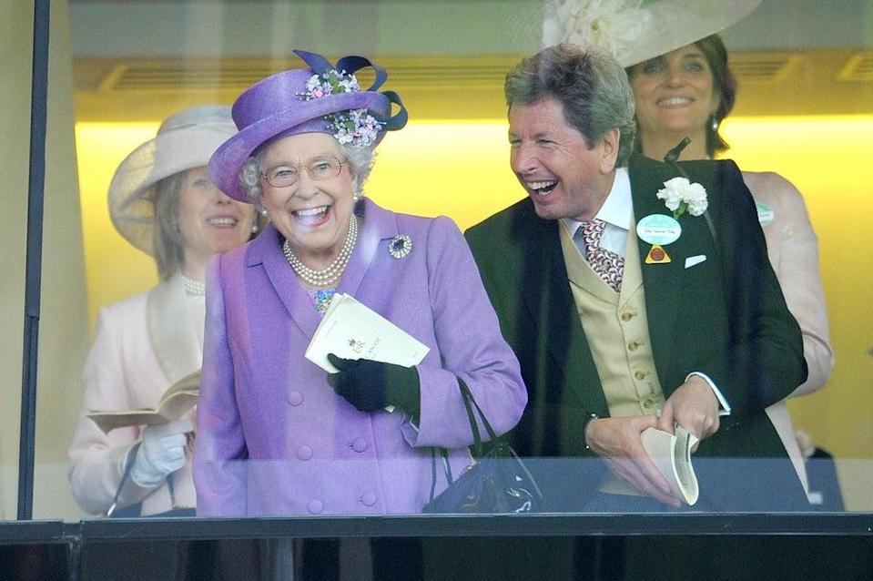 The Queen with her racing manager John Warren after her horse, Estimate, won the Gold Cup in 2013 (Tim Ireland/PA) (PA Archive)