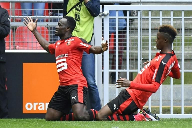 Rennes' forward Firmin Mubele (L) celebrates after scoring during a French L1 football match against Lyon at Roazhon Park stadium in Rennes on April 2, 2017