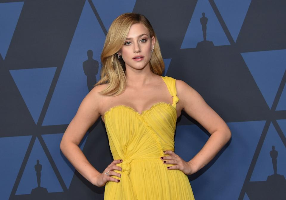 US actress Lili Reinhart arrives to attend the 11th Annual Governors Awards gala hosted by the Academy of Motion Picture Arts and Sciences at the Dolby Theater in Hollywood on October 27, 2019. (Photo by Chris Delmas / AFP) (Photo by CHRIS DELMAS/AFP via Getty Images)