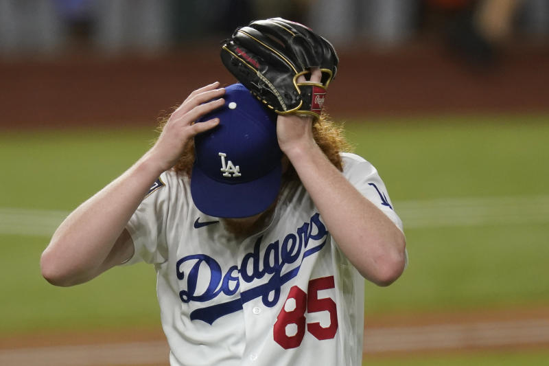 Los Angeles Dodgers starting pitcher Dustin May reacts after giving up a two-run home run to Tampa Bay Rays' Brandon Lowe during the fifth inning in Game 2 of the baseball World Series Wednesday, Oct. 21, 2020, in Arlington, Texas. (AP Photo/Eric Gay)