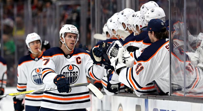 Connor McDavid of the Edmonton Oilers celebrates with teammates after collecting the 400th point of his career, a goal, against the Anaheim Ducks on Sunday. (Photo by Sean M. Haffey/Getty Images)