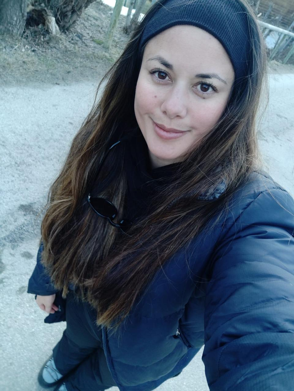 Intan Clement, who contracted coronavirus, takes a selfie on a cold day.