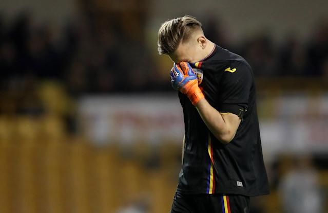 Soccer Football - Under 21 International Friendly - England vs Romania - Molineux Stadium, Wolverhampton, Britain - March 24, 2018 Romania's Ionut Radu looks dejected Action Images via Reuters/Carl Recine