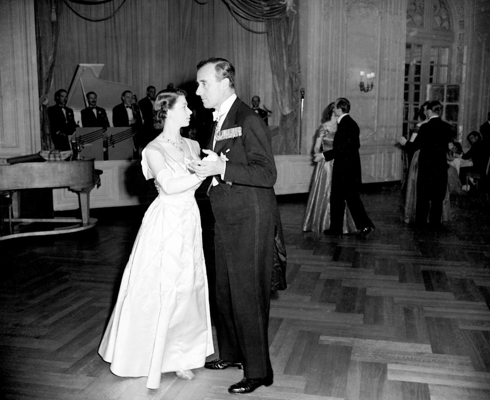 <p>Princess Elizabeth dances with Earl Mountbatten of Burma at the ball organised by the Central Appeal Council of the Royal College of Nursing and held at the Savoy Hotel (PA Archive) </p>