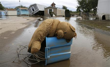 A stuffed teddy bear chair lies slumped over in the flooded Eastwood Village in Evans, Colorado September 23, 2013. REUTERS/Rick Wilking