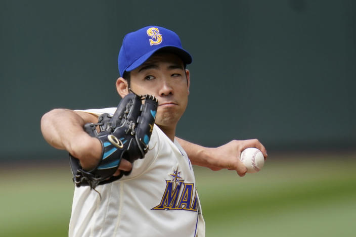 Seattle Mariners starting pitcher Yusei Kikuchi throws against the Texas Rangers in the sixth inning of a baseball game Sunday, May 30, 2021, in Seattle. (AP Photo/Elaine Thompson)