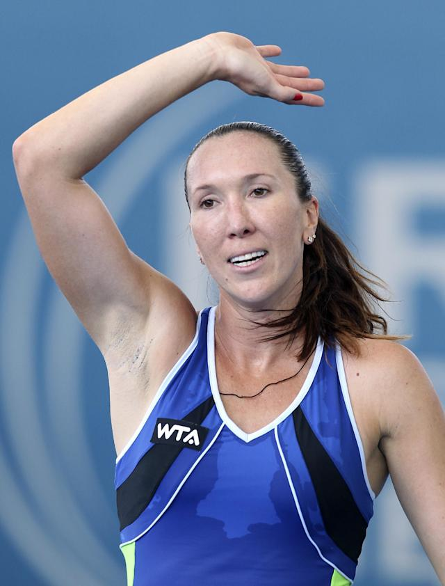 Jelena Jankovic of Serbia waves at the crowd after defeating Francesca Schiavone of Italy during the Brisbane International tennis tournament in Brisbane, Australia, Monday, Dec. 30, 2013. (AP Photo/Tertius Pickard)